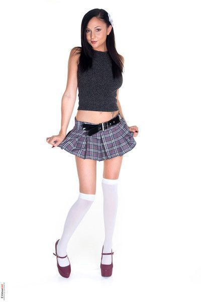 Hot brunette in her white socks plaid skirt and stilettos