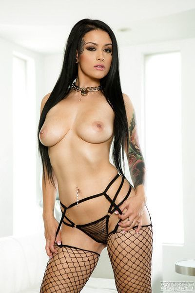 Gorgeous brunette pornstar Katrina Jade striking hot solo poses in fishnets