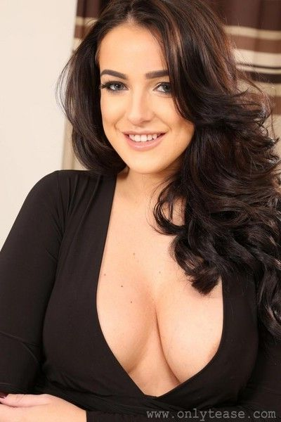 Busty curvy brunette in a tight dress