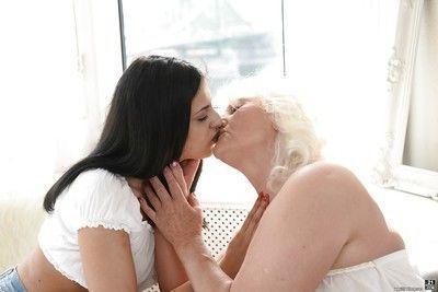 Mature lady Judi and barely legal cutie Coco de Mal have lesbian sex