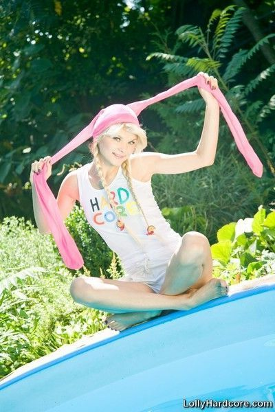 Blonde teen cutie in pigtails showing off amazing body