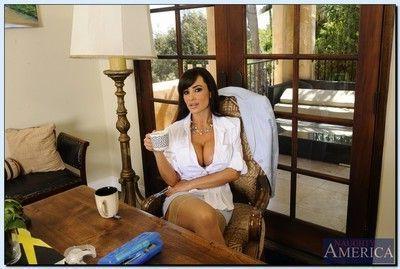 Ravishing mature teacher Lisa Ann getting naked and exposing her twat