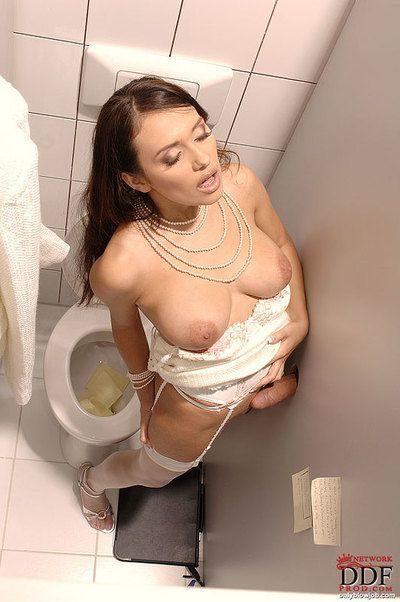 Sticking attired babe Nataly Brown giving blowjob in bathroom gloryhole