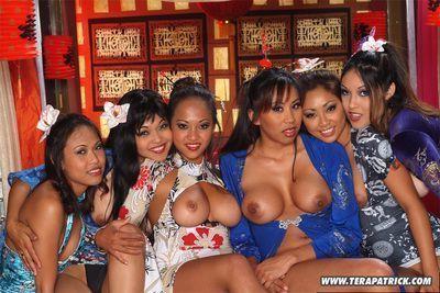 Sexy Asian pornstars in heels flaunt their big boobs in hot lesbian orgy