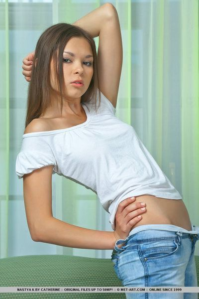 Petite brunette beauty Nastya removes her clothes to uncover her twat