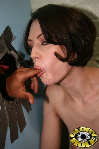 Sexy sarah shevon taking care of a long black gloryhole shlong