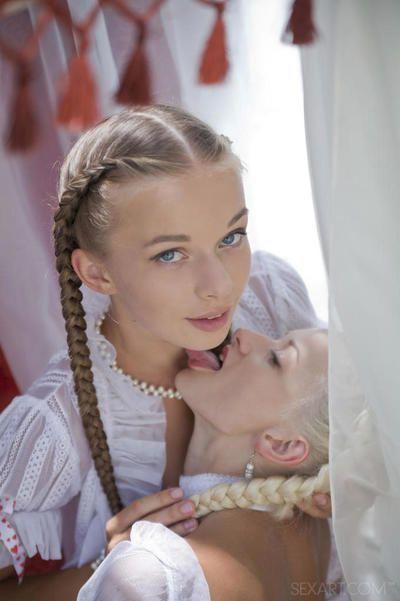 Skinny teen girls Milena D & Nika N in pigtails kiss & eat pussy outdoors