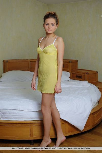 Petite Euro girl Colleen A slipping out of lingerie to bare very tiny tits