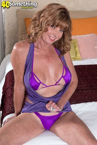 Sexy mature lady showing her perfect body