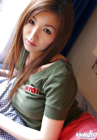 Stunning asian teenage babe Mai Hanano stripping off her clothes