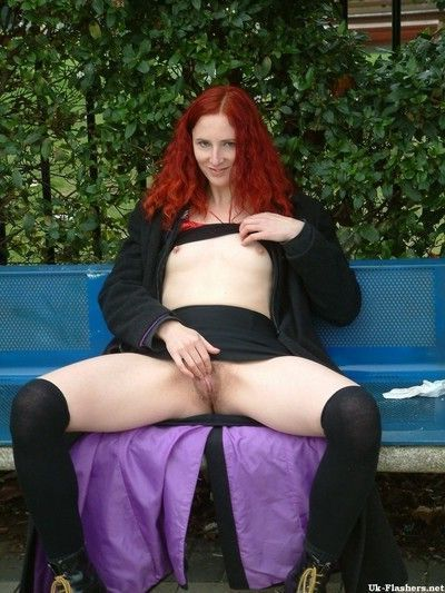 Amateur redhaired exhibitionist plays with her pussy outdoors on