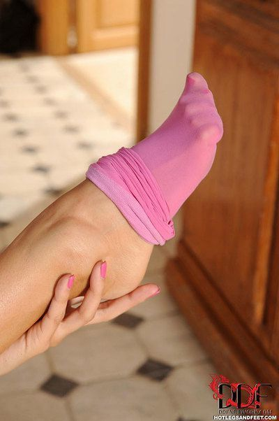 Long legged Anissa Kate in shorts and sock shows hot feet while toying