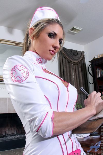 Sexy MILF freeing large tits from nurse uniform before masturbating
