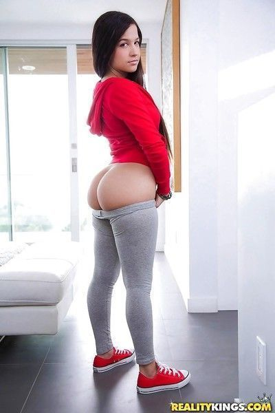 Brunette solo girl Caroline Ray freeing juicy ass & bush from spandex pants
