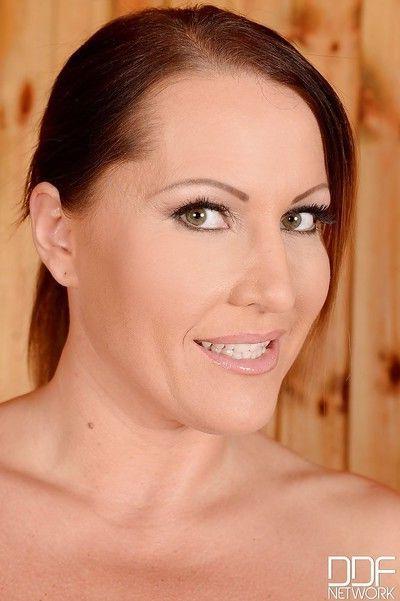 European milf with really big tits Laura Orsolya frolics in the sauna