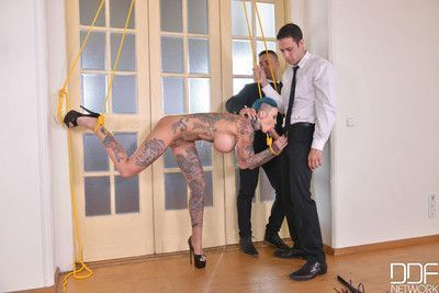 Calisi ink gets double penetrated by two kinky studs