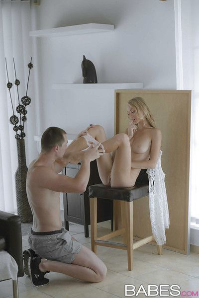 Beautiful blond chick Nancy A showing off perfect ass before giving handjob