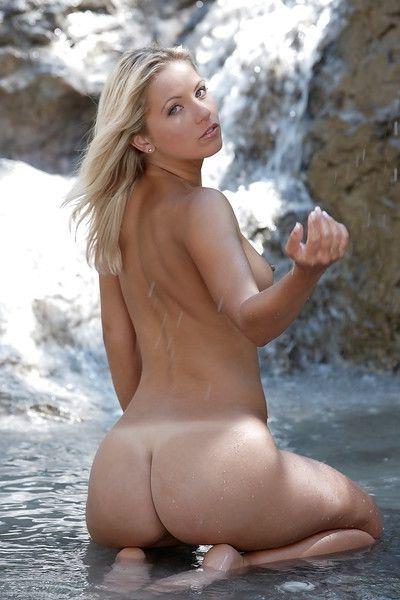 Tanned babe pornstar with a big ass is touching herself outdoor