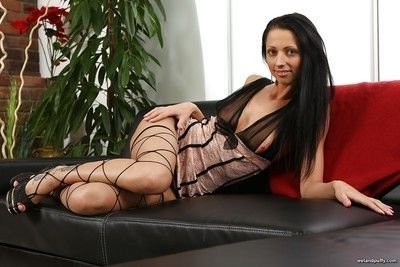 Thin brunette July Sun strips down to sexy stockings to spread labia lips