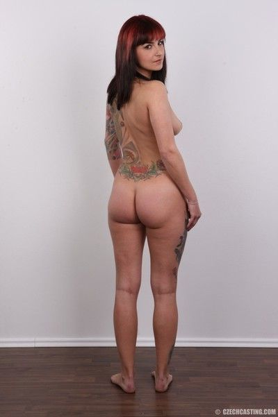 Tattooed babes poses for camera