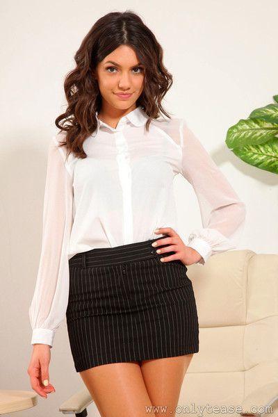 Brunette secretary strips at the office