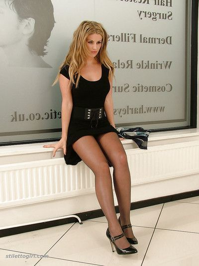 Kathryn is demonstrating her legs in high heels and black skirt